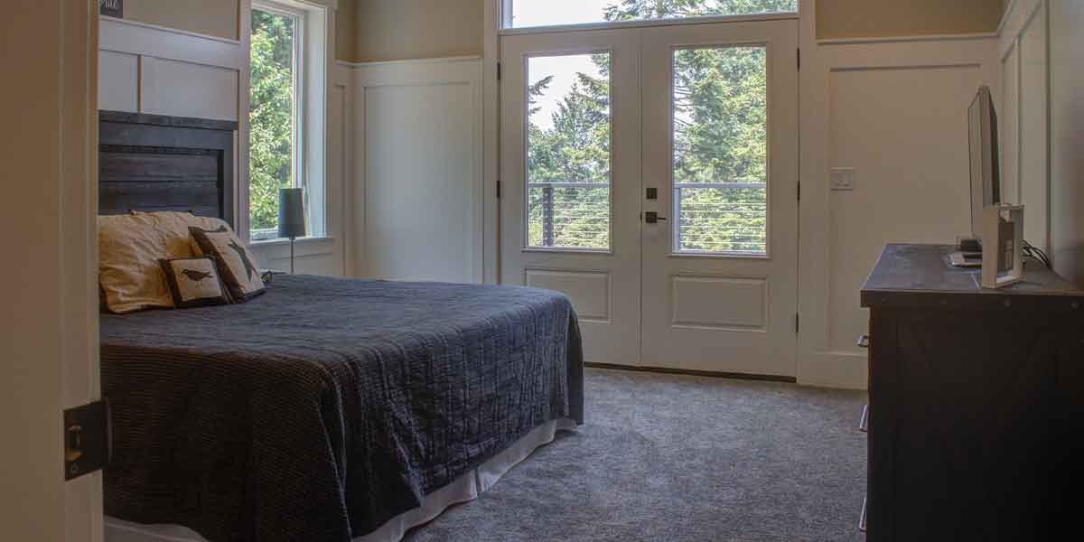 Bedroom of Contemporary Farmhouse by Mike Riddle Construction
