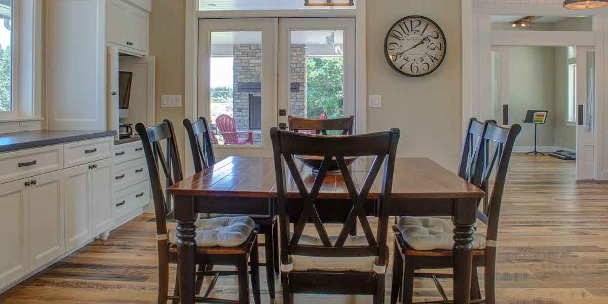 Dining Area of Contemporary Farmhouse by Mike Riddle Construction