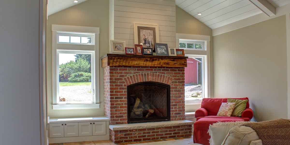 Fireplace of Contemporary Farmhouse by Mike Riddle Construction