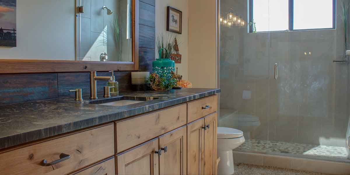 Bathroom in a Northwest Lodge by Mike Riddle Construction