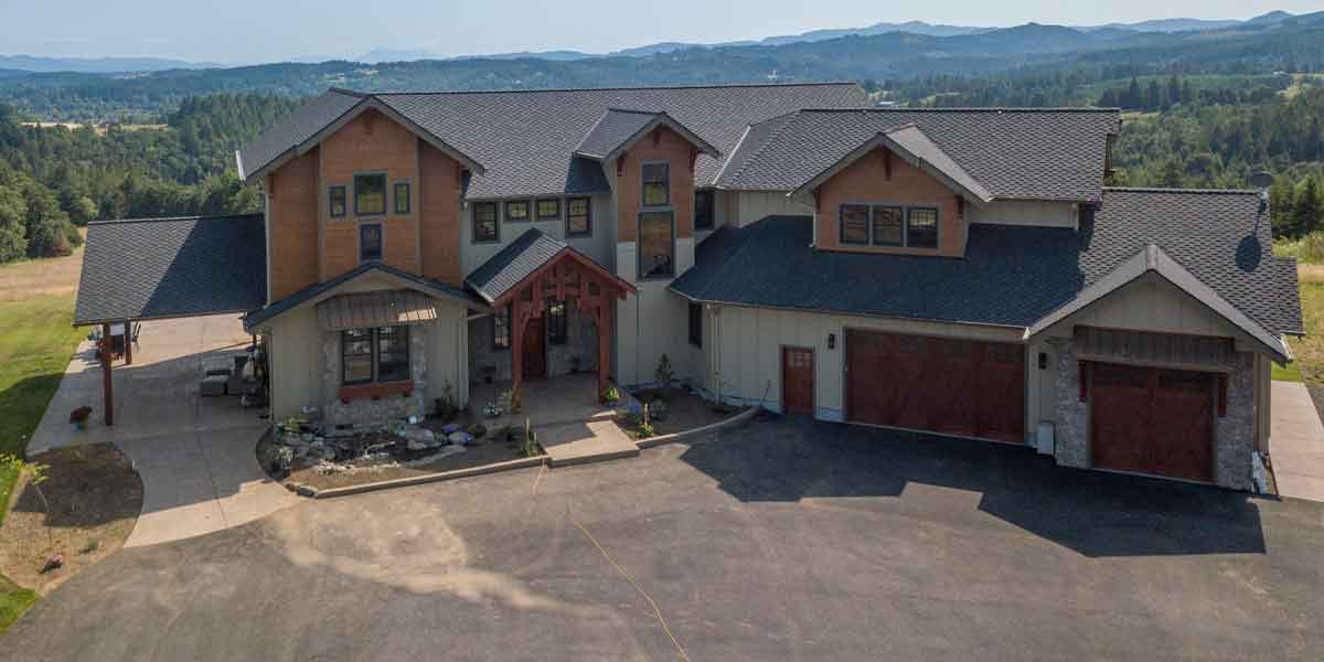 Aerial View of a Northwest Lodge by Mike Riddle Construction