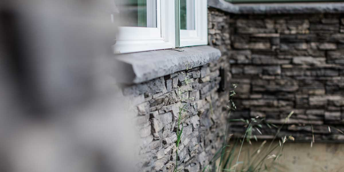 Exterior Rock on a Country Ranch by Mike Riddle Construction