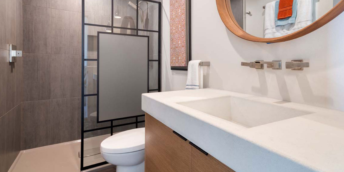 Bathroom in Modern Iconic Custom Home by Mike Riddle Construction