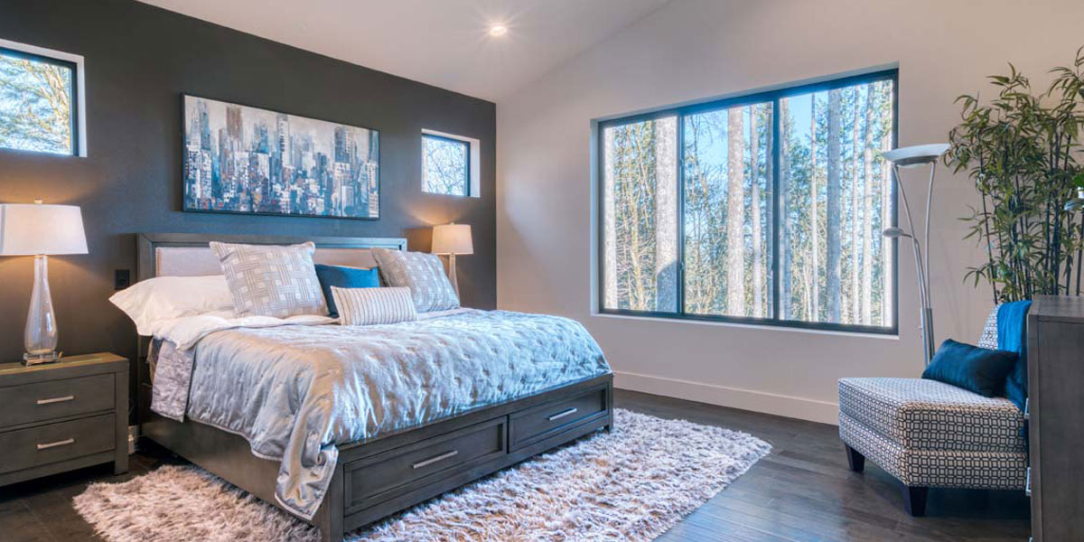 Bedroom in Modern Iconic Custom Home by Mike Riddle Construction