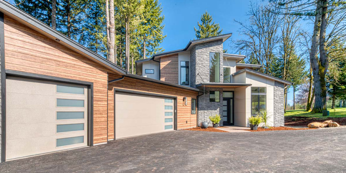 Exterior of Modern Iconic Custom Home by Mike Riddle Construction
