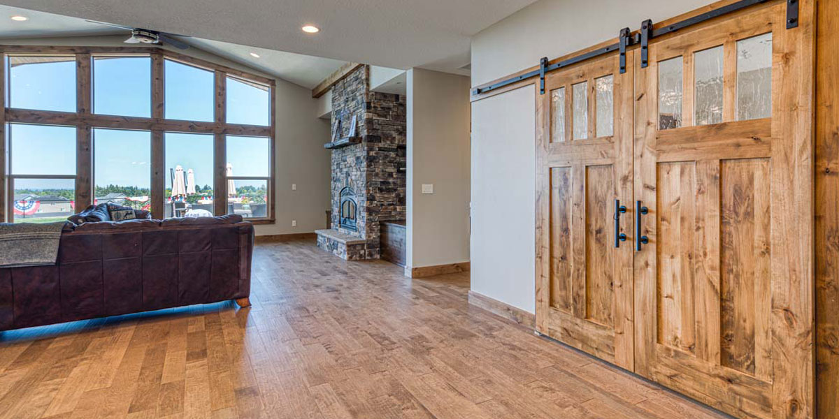 Great Room in Rustic Chic Custom Home by Mike Riddle Construction