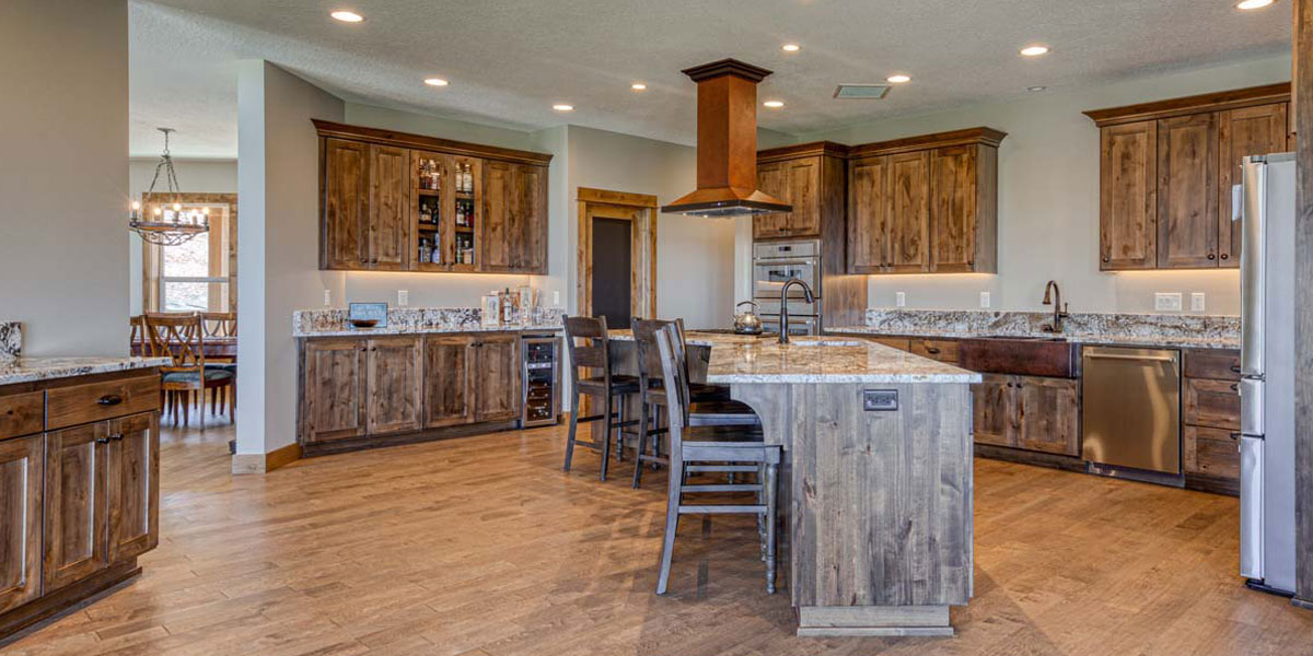 Kitchen in Rustic Chic Custom Home by Mike Riddle Construction