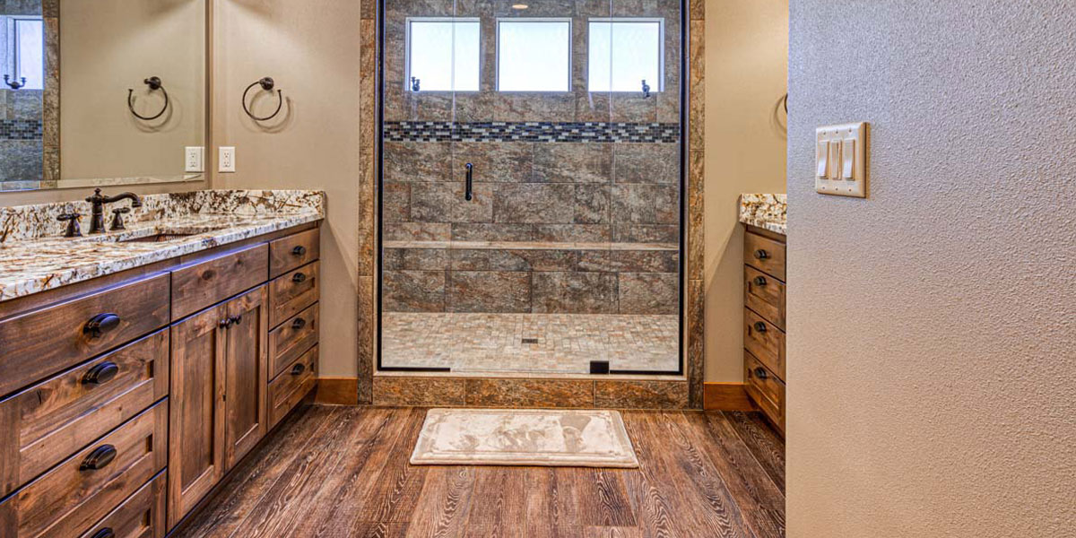Master Bathroom in Rustic Chic Custom Home by Mike Riddle Construction
