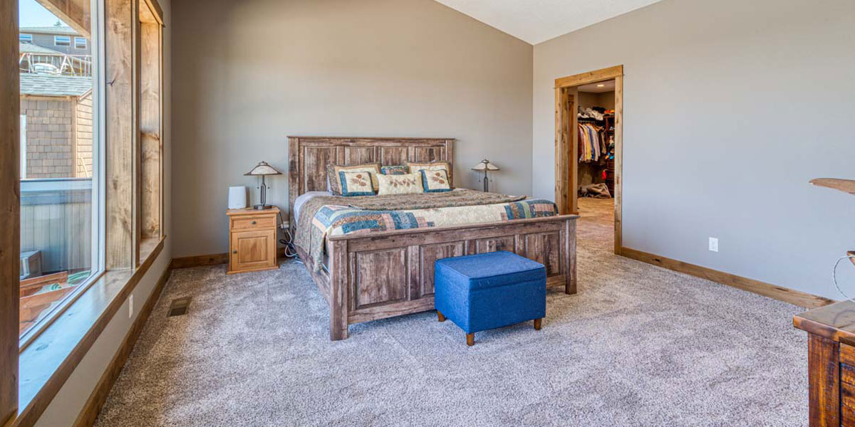 Master Bedroom in Rustic Chic Custom Home by Mike Riddle Construction