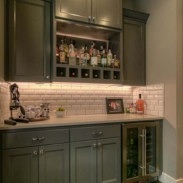 Bar in Family Retreat by Mike Riddle Construction