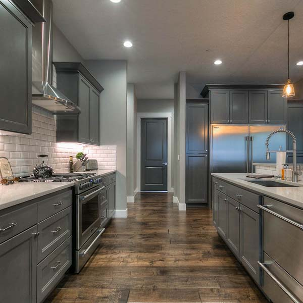 Kitchen in Family Retreat by Mike Riddle Construction
