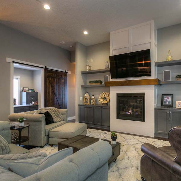Fireplace in Family Retreat by Mike Riddle Construction