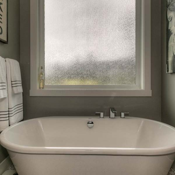 Bathtub in Family Retreat by Mike Riddle Construction