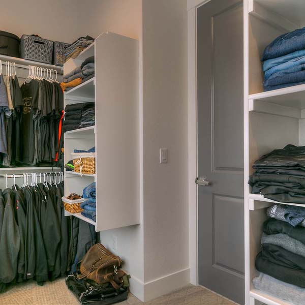 Closet in Family Retreat by Mike Riddle Construction