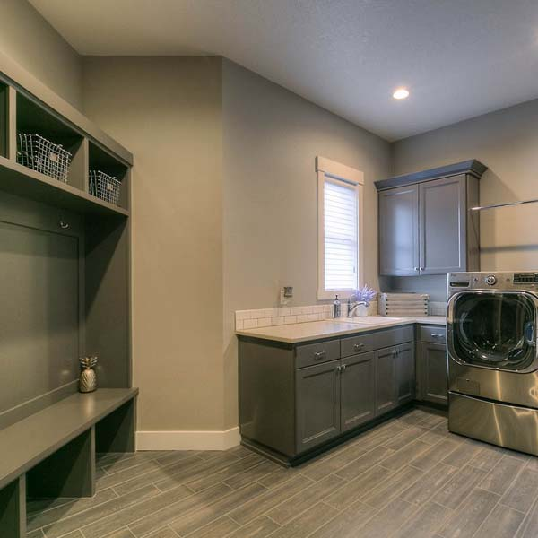 Laundry in Family Retreat by Mike Riddle Construction