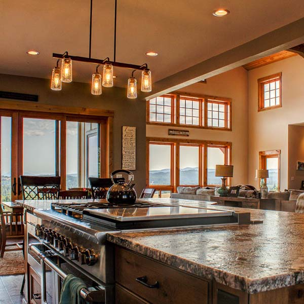 Kitchen in Northwest Lodge by Mike Riddle Construction