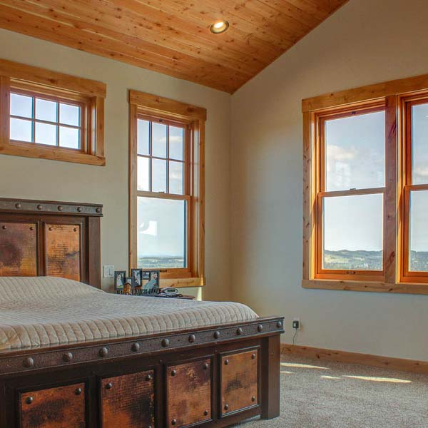 Bedroom in Northwest Lodge by Mike Riddle Construction