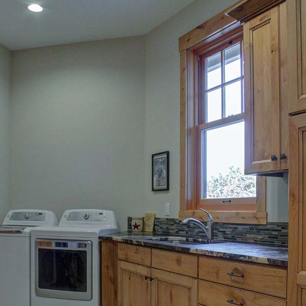 Laundry in Northwest Lodge by Mike Riddle Construction