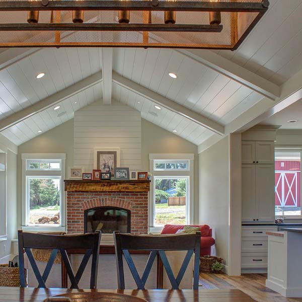 Fireplace Area in Contemporary Farmhouse by Mike Riddle Construction