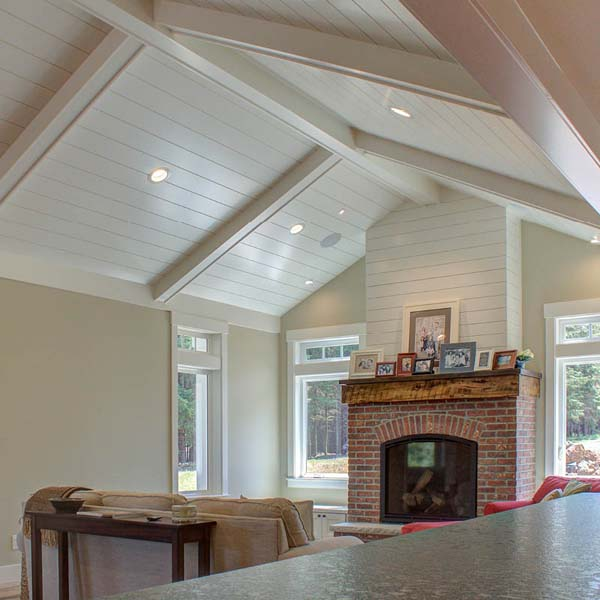 Fireplace in Contemporary Farmhouse by Mike Riddle Construction