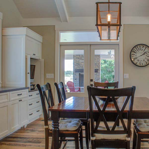 Kitchen Eating Area in Contemporary Farmhouse by Mike Riddle Construction