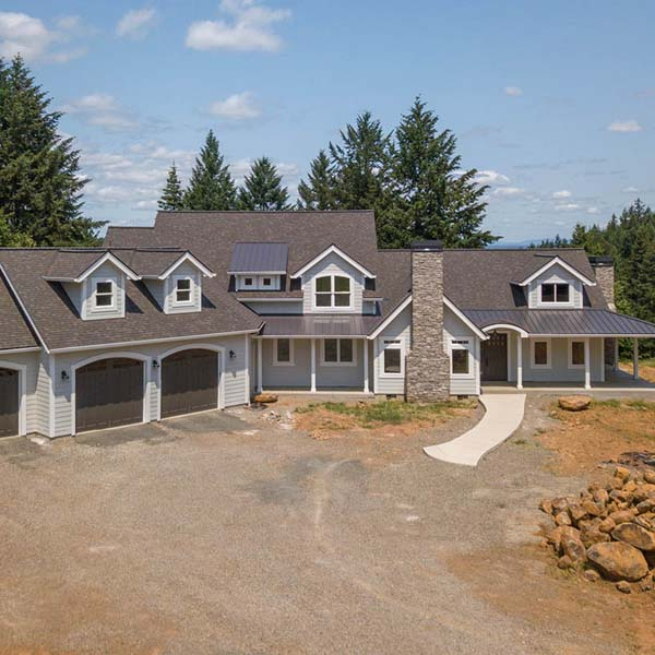 Exterior View of Contemporary Farmhouse by Mike Riddle Construction