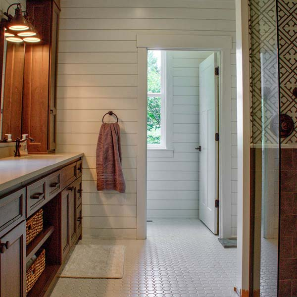 Bathroom in Contemporary Farmhouse by Mike Riddle Construction