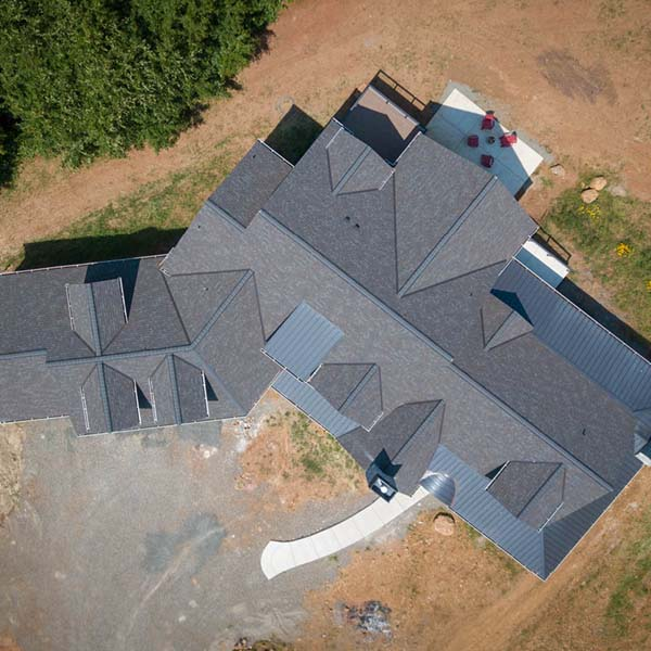 Aerial View of Contemporary Farmhouse by Mike Riddle Construction