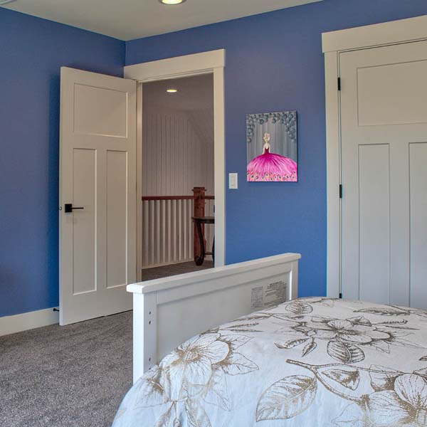 Bedroom in Contemporary Farmhouse by Mike Riddle Construction