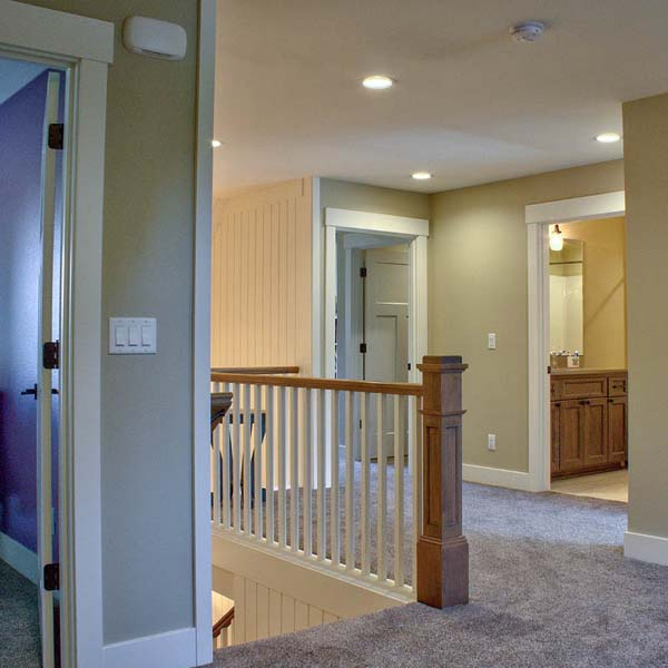 Upstairs Hallway in Contemporary Farmhouse by Mike Riddle Construction