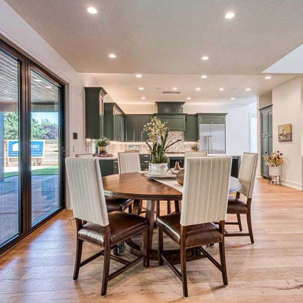 Dining Area in Modern Tudor by Mike Riddle Construction