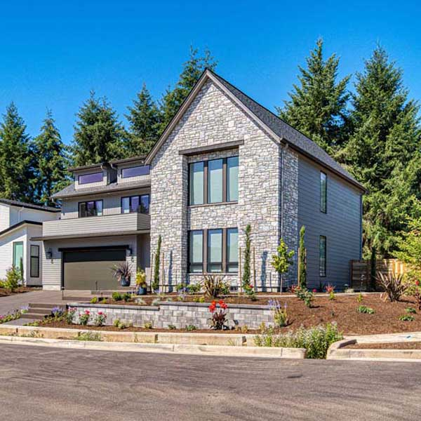 Exterior of Modern Tudor by Mike Riddle Construction