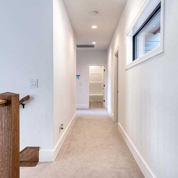 Hallway in Modern Tudor by Mike Riddle Construction