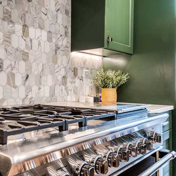 Kitchen in Modern Tudor by Mike Riddle Construction