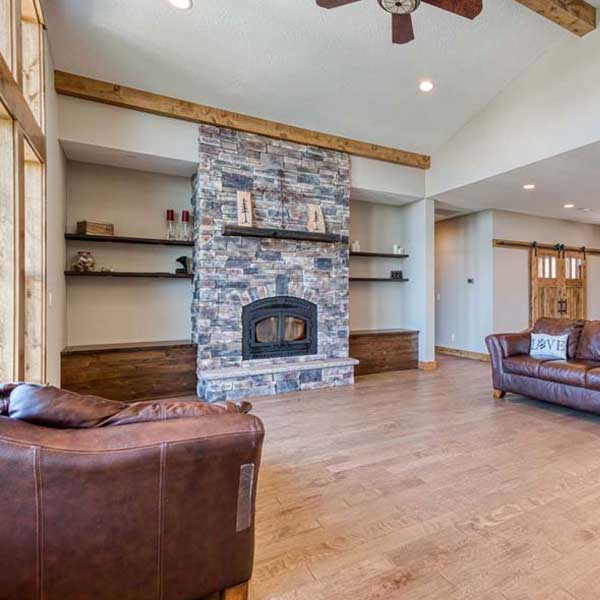 Living Area in Rustic Chic by Mike Riddle Construction