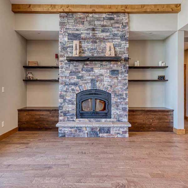 Fireplace in Rustic Chic by Mike Riddle Construction