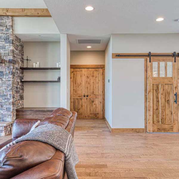 Great Room in Rustic Chic by Mike Riddle Construction