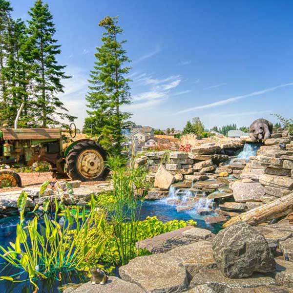 Landscape at Rustic Chic by Mike Riddle Construction