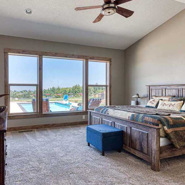 Master Bedroom in Rustic Chic by Mike Riddle Construction